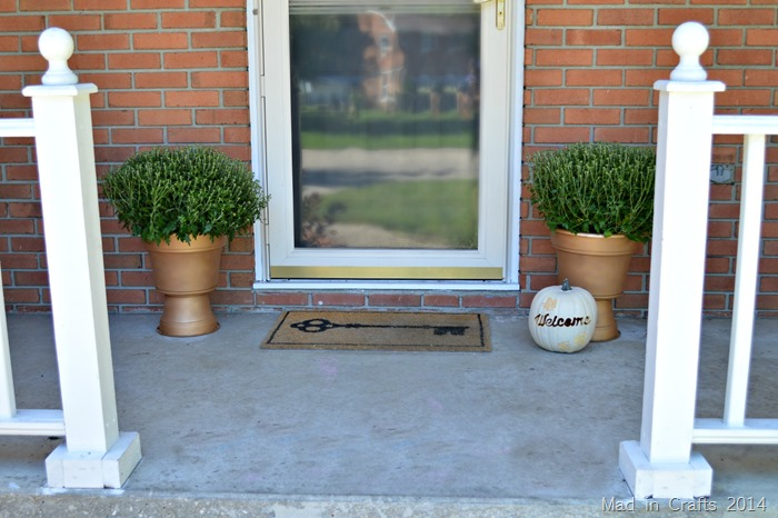 faux bronze pedestal planter on either side of front door