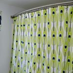MAKE A GROMMET-TOPPED SHOWER CURTAIN