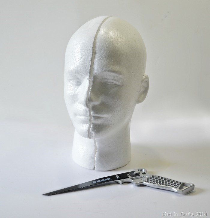 Saw head in half