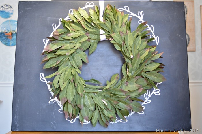 Add wreath to chalkboard