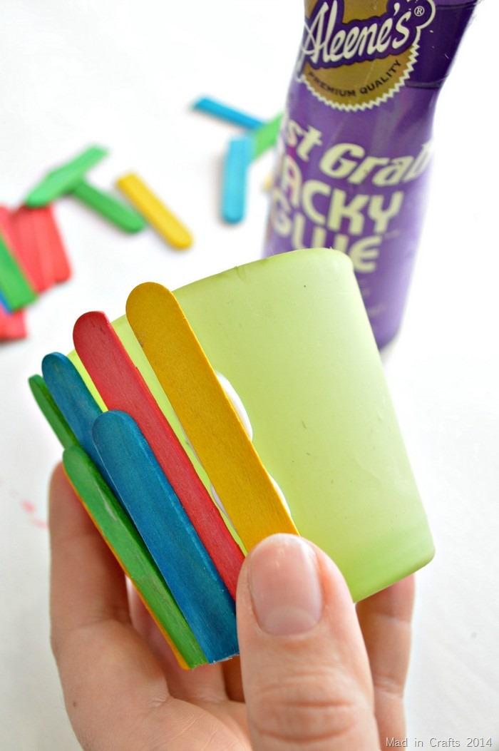 glue craft sticks to planter