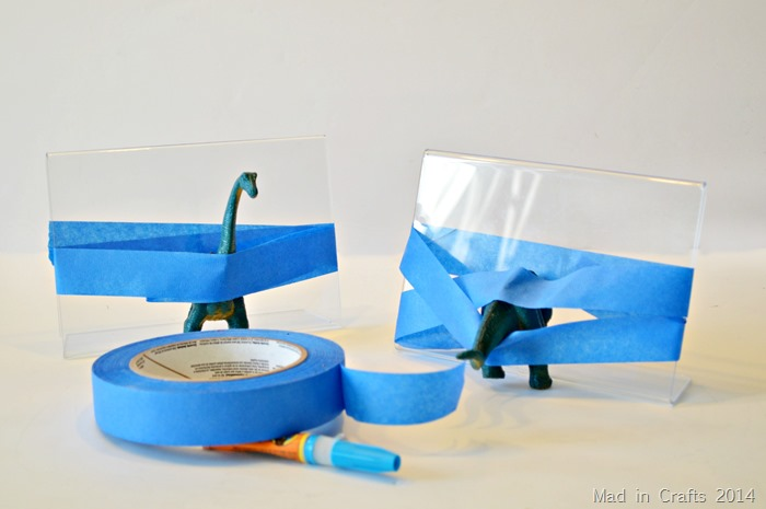 Plastic Animal Bookends tape halves in place to dry