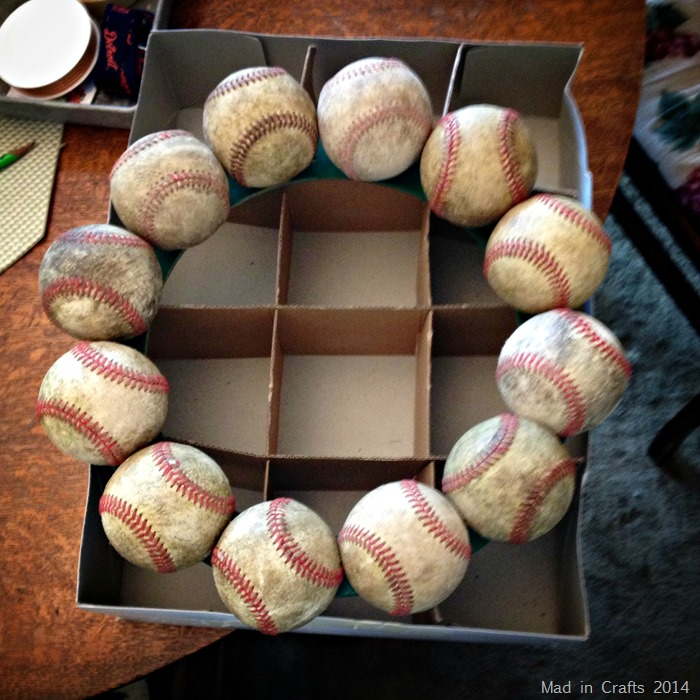 Screw baseballs on wreath form