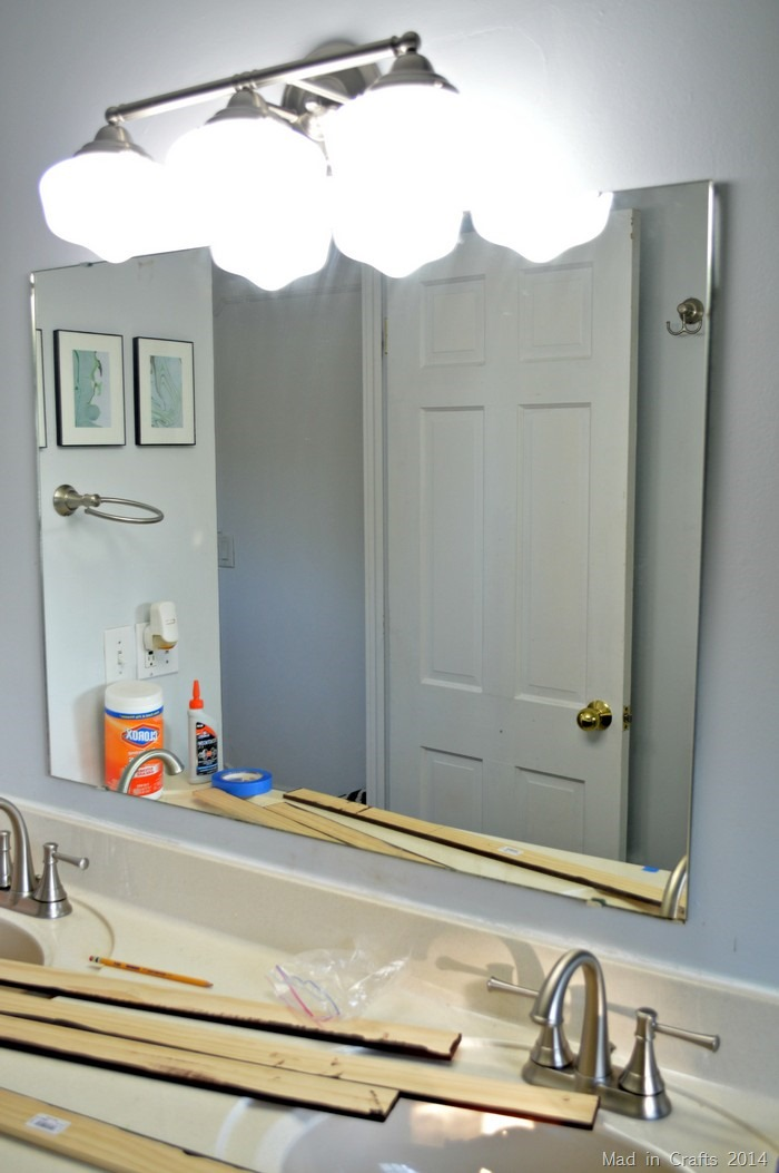 unframed bathroom mirror
