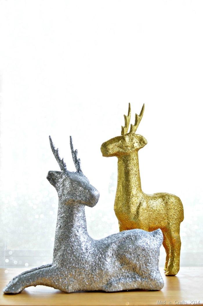 a glittered paper mache deer