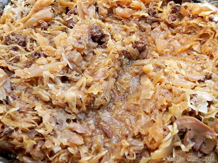 close up of kapusta saurkraut with sausage