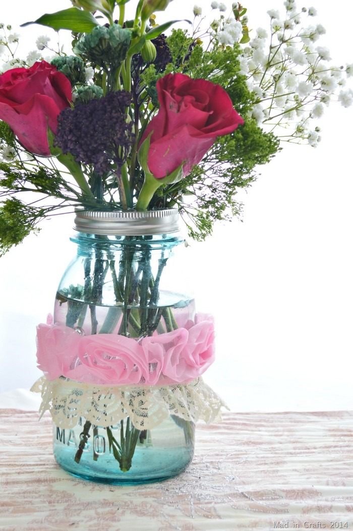 add ribbon and lace to centerpiece