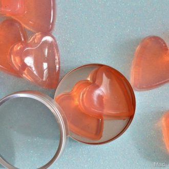 DIY Jelly soap shaped like hearts on a blue background