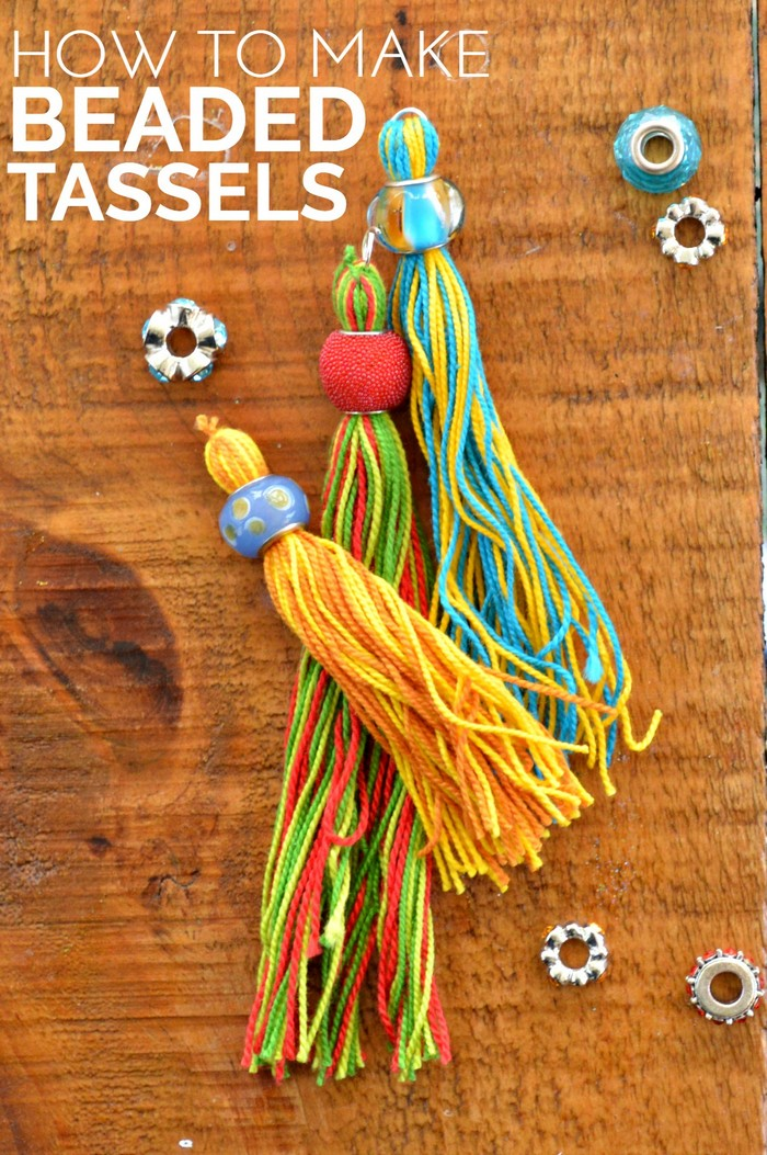 Bead and embroidery floss tassels on a wood table