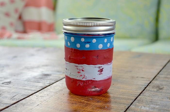 flag painted mason jar on a wood table