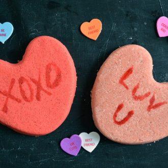 conversation Heart shaped Bath bombs on a black background