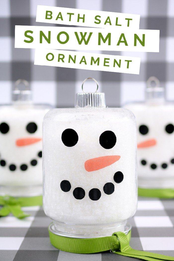snowman mason jar ornaments on a plaid background