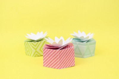 Paper gift boxes made with Cricut on a yellow background