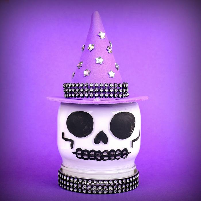 witch skull mason jar on a purple background