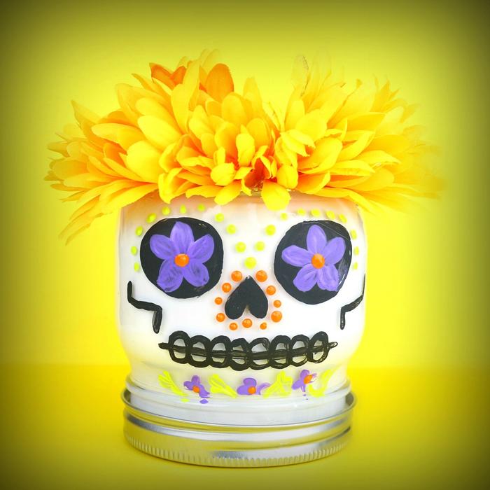 Dia de los Muertos skull mason jar on a yellow background