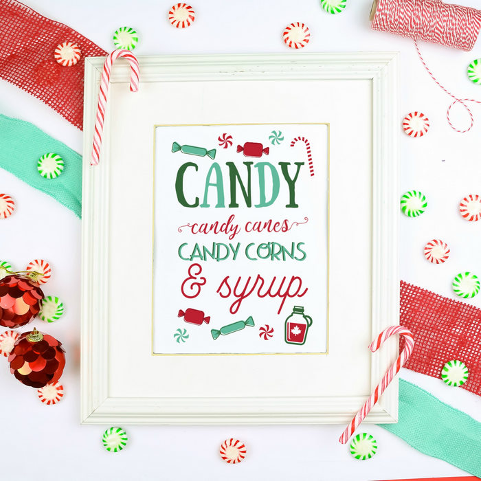 Elf Quote printable in a white frame with candy, ribbon, and twine