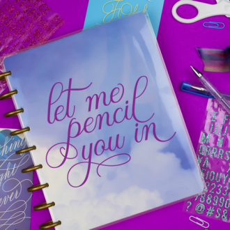 planner with vinyl that reads Let Me Pencil You In next to journalling supplies