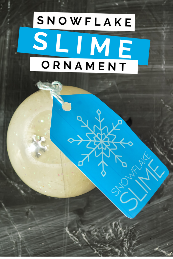 plastic ornament filled with slime, blue tag on a black background