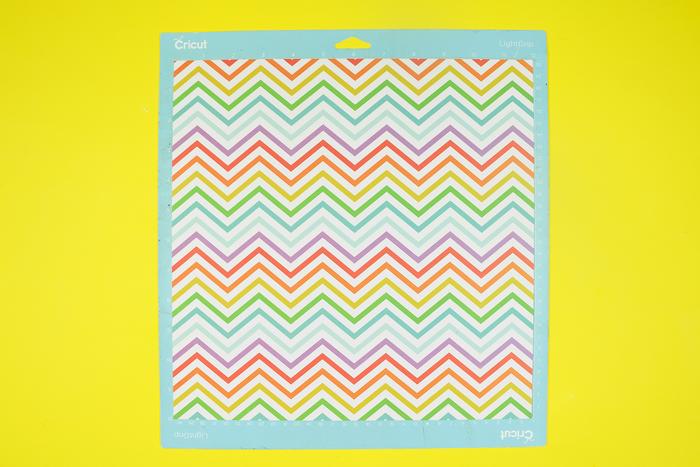 colorful chevron paper on a Cricut mat