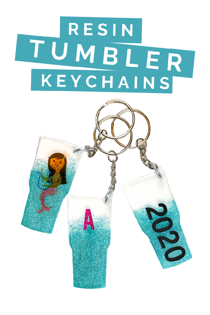 3 diy resin tumbler shaped key chains on a white background
