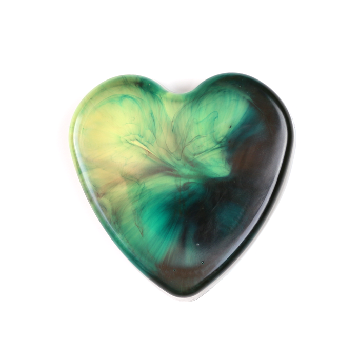blue resin heart paperweight on a white background