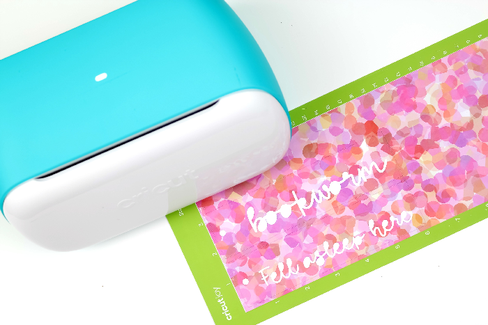 Cricut joy, cutting mat, bookmarks on a white background