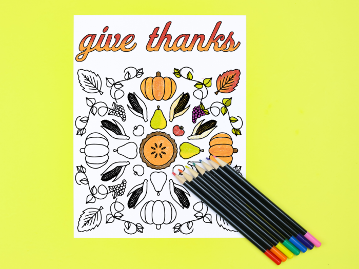 Give thanks coloring page with colored pencils on a yellow background