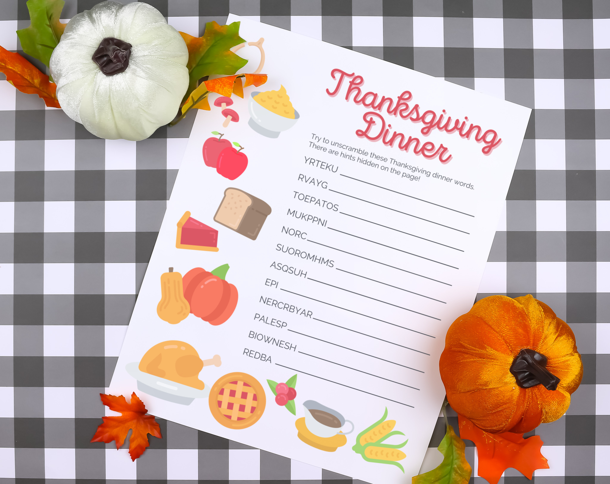 Thanksgiving word scramble printable on a plaid background with pumpkins