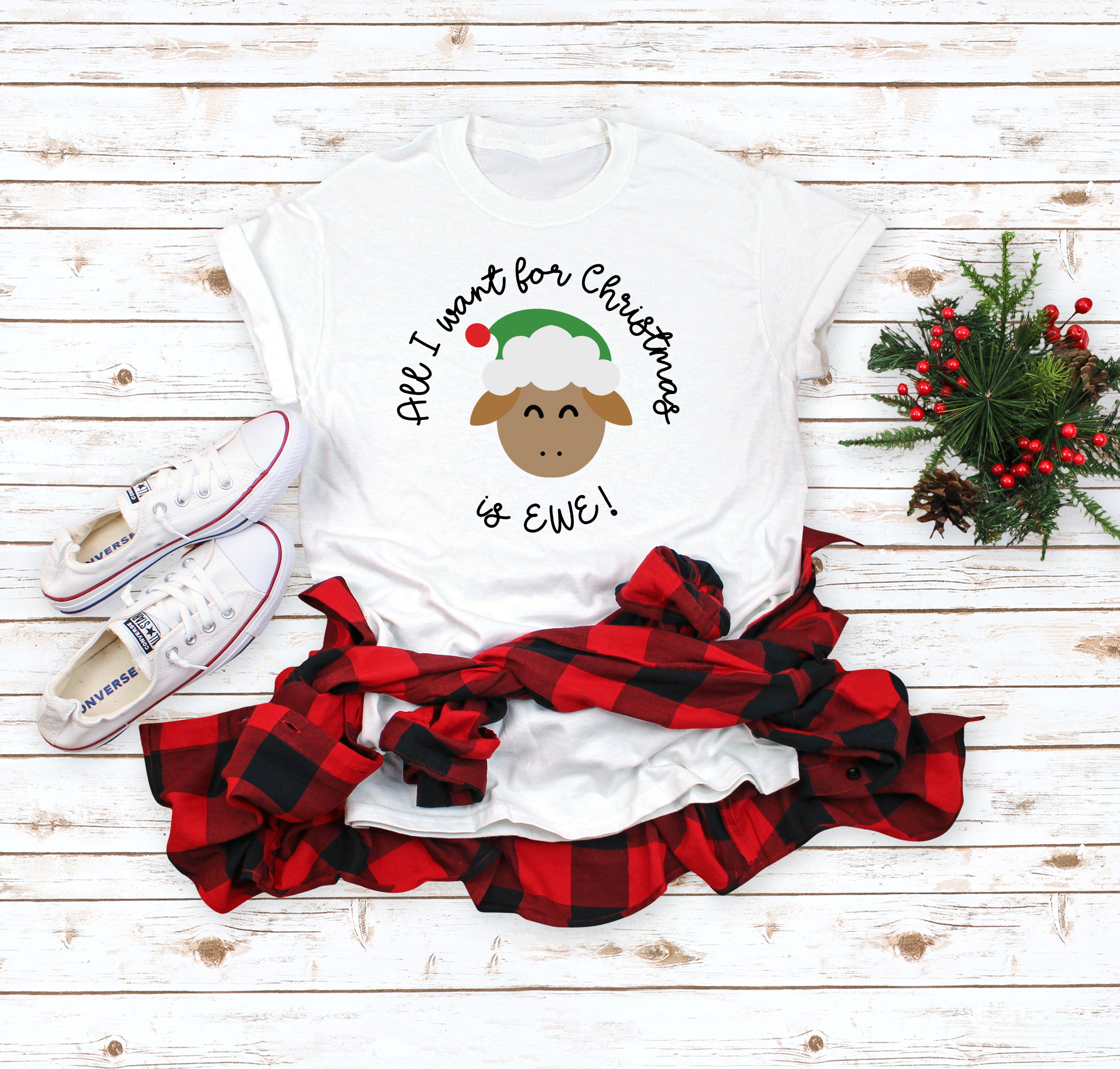 All I Want for Christmas is EWE SVG design on a white t-shirt with red and black flannet