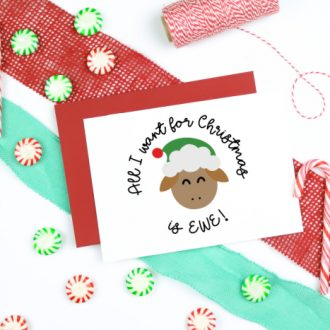 All I Want for Christmas is EWE design on white christmas card with candy and baker's twine