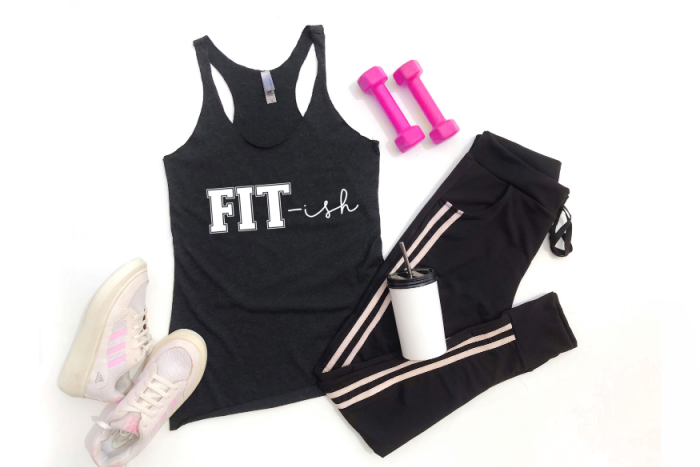 A flat lay of black workout gear with a design that says FIT-ish