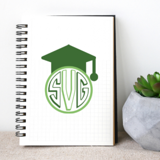 White notebook with green graduation monogram SVG design next to a succulent