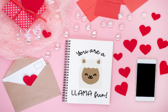 llama svg on a notebook with valentine decorations