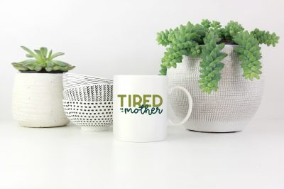 Tired as a Mother SVG file on a mug by houseplants